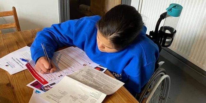 A Teen Members Fills In Her Hospital Passport, Given By SHASBAH