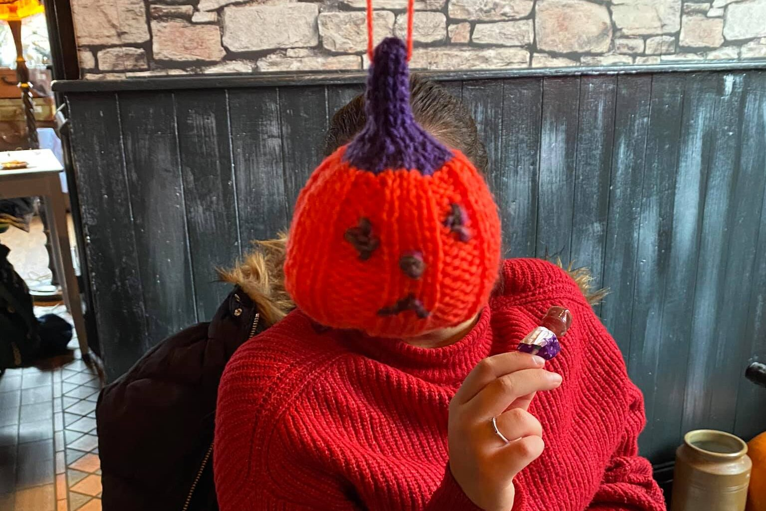 A knitted pumpkin gift was part of the Halloween experience.