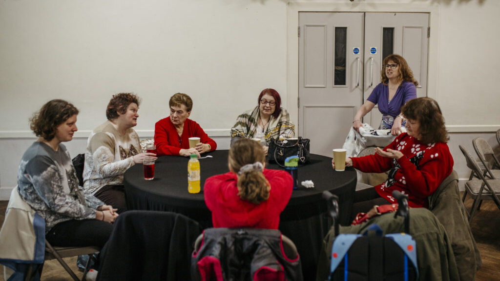 A group of women sit around a table at our weekly craft group in Sheffield.