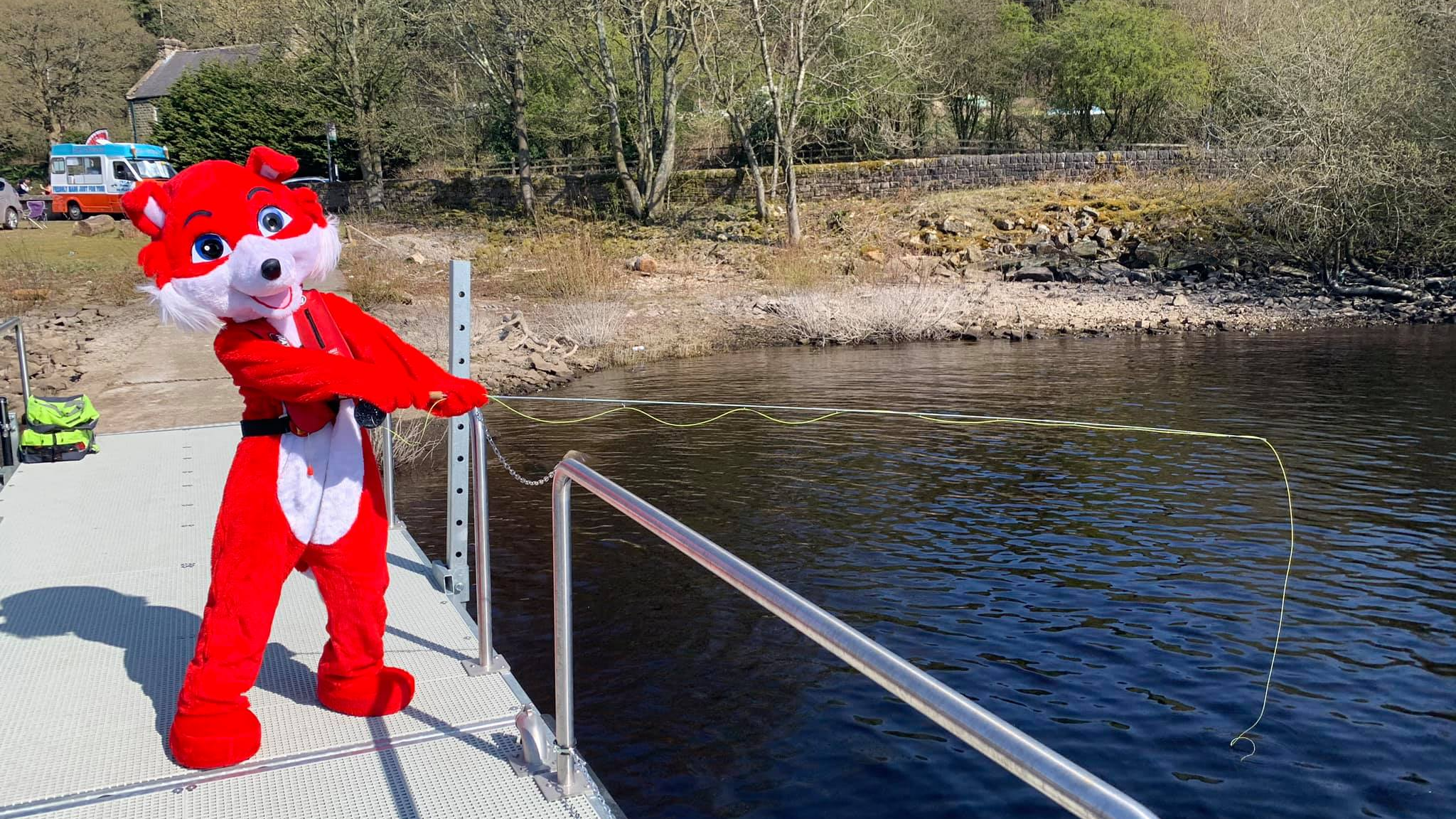 Our Mascot, Shasby The Forgetful Fox, Is Fishing From The Accessible Pontoon.
