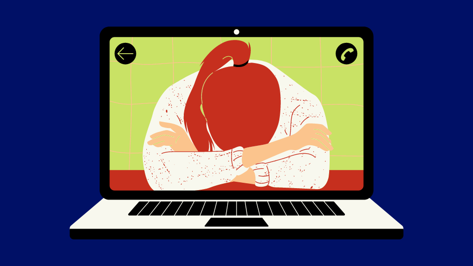A woman shown on a laptop screen sits with her head in her hands.