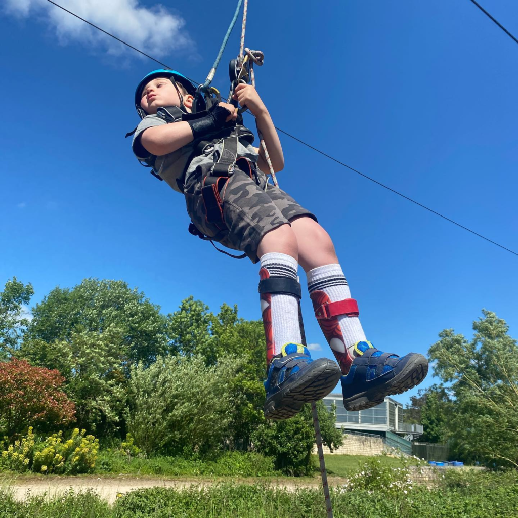 A young boy has a go on the zipline.